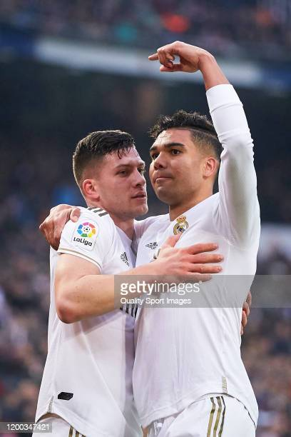 Casemiro of Real Madrid celebrates after scoring his team's first goal with his teammate Luka Jovic during the Liga match between Real Madrid CF and...