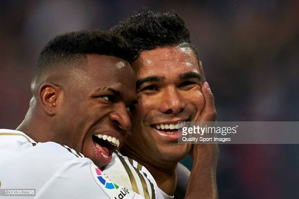 Casemiro of Real Madrid celebrates after scoring his team's second goal with his teammate Vinicius Junior during the Liga match between Real Madrid...