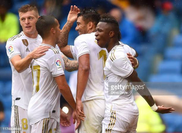 Casemiro of Real Madrid celebrates after scoring his team's third goal with his team mates during the La Liga match between Real Madrid CF and...