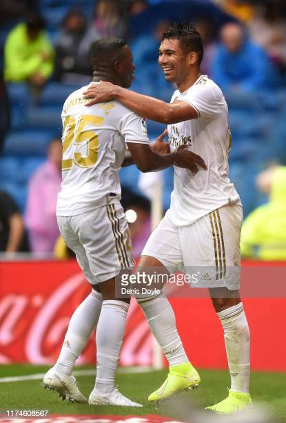 Casemiro of Real Madrid celebrates after scoring his team's third goal with Vinicius Junior of Real Madrid during the La Liga match between Real...