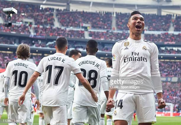 Casemiro of Real Madrid celebrates scoring his team's opening goal with team mates during the La Liga match between Club Atletico de Madrid and Real...