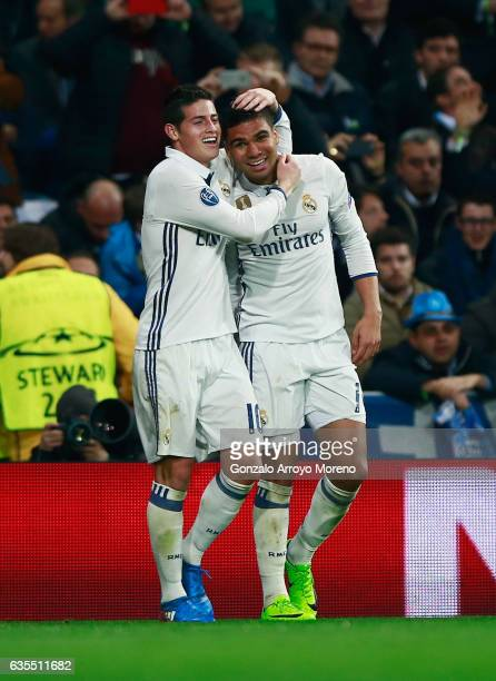 Casemiro of Real Madrid celebrates with James Rodriguez as he scores their third goal during the UEFA Champions League Round of 16 first leg match...