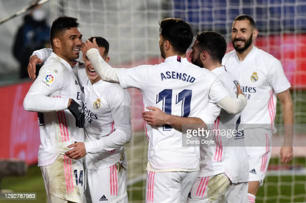 Casemiro of Real Madrid celebrates with Marco Asensio, Karim Benzema and team mates after scoring their sides first goal during the La Liga Santander...