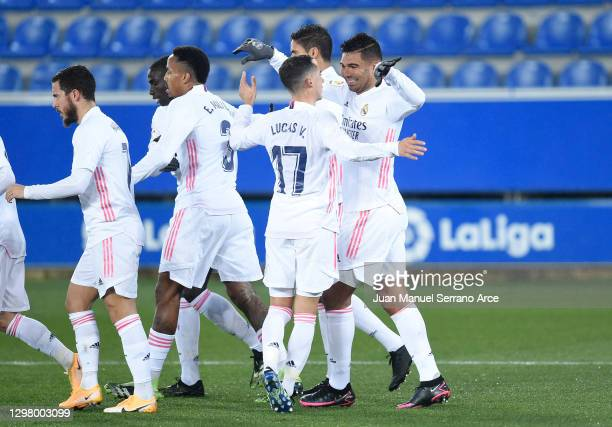 Casemiro of Real Madrid celebrates with teammate Lucas Vazquez after scoring their team's first goal during the La Liga Santander match between...