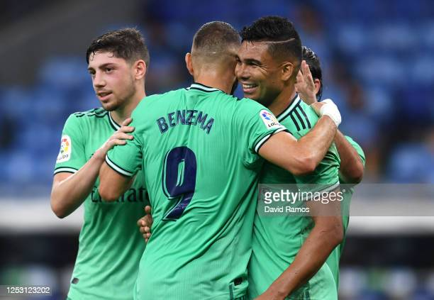 Casemiro of Real Madrid celebrates with teammates after scoring his sides first goal during the Liga match between RCD Espanyol and Real Madrid CF at...