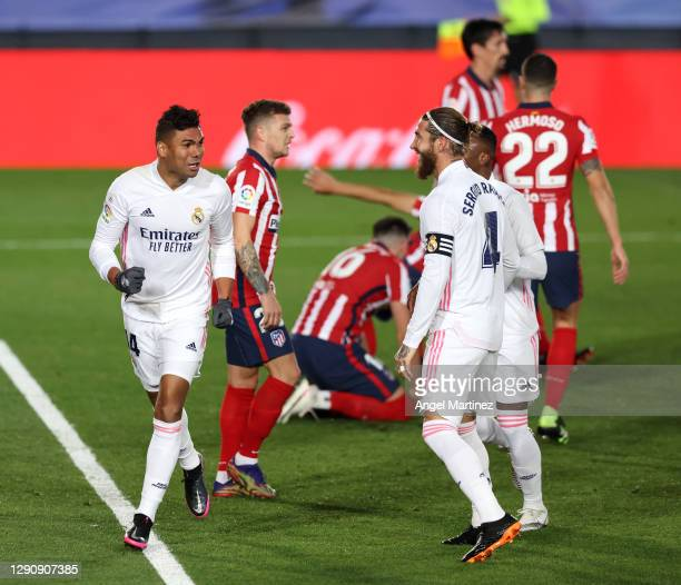 Casemiro of Real Madrid celebrates with teammates Sergio Ramos and Vinicius Junior after scoring their sides first goal during the La Liga Santander...