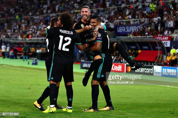 Casemiro of Real Madrid celebrates with teammates Sergio Ramos and Marcelo after opening the scoring during the UEFA Super Cup match between Real...