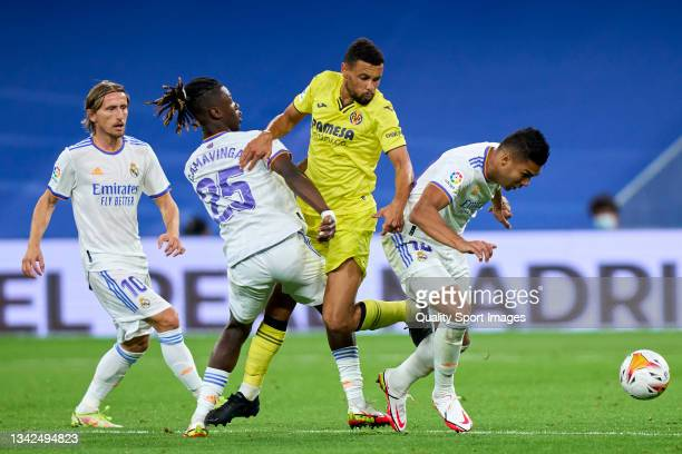 Casemiro of Real Madrid CF battles for the ball with Francis Coquelin of Villarreal CF during the La Liga Santander match between Real Madrid CF and...