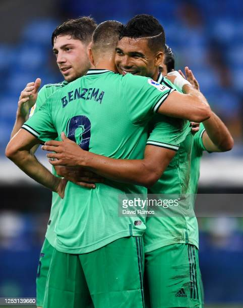 Casemiro of Real Madrid CF celebrates with his team mate Karim Benzema after scoring his team's first goal during the Liga match between RCD Espanyol...