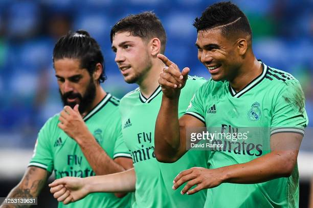 Casemiro of Real Madrid CF celebrates with his team mates Isco and Federico Valverde after scoring his team's first goal during the Liga match...