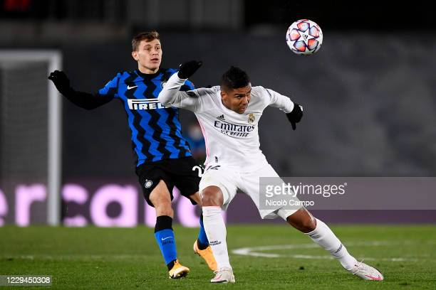 Casemiro of Real Madrid CF competes for the ball with Nicolo Barella of FC Internazionale during the Champions League Group B football match between...