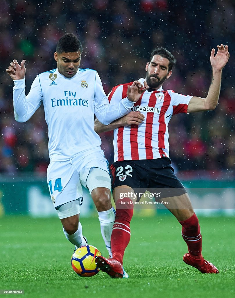 Casemiro of Real Madrid CF (L) competes for the ball with Raul Garcia of Athletic Club (R) during the La Liga match between Athletic Club and Real Madrid at Estadio de San Mames on December 2, 2017 in Bilbao, Spain.
