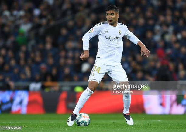 Casemiro of Real Madrid CF runs with the ball during the Liga match between Real Madrid CF and FC Barcelona at Estadio Santiago Bernabeu on March 01...