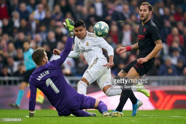 Casemiro of Real Madrid CF scores his team's first goal during the Liga match between Real Madrid CF and Sevilla FC at Estadio Santiago Bernabeu on...