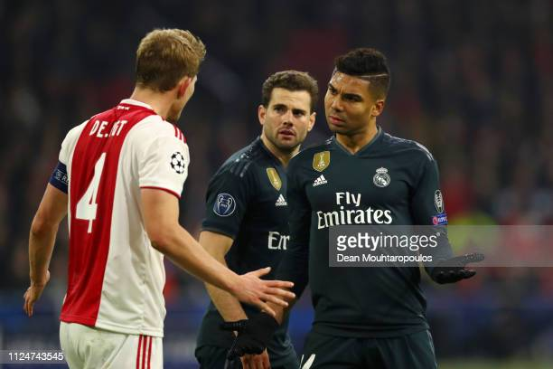 Casemiro of Real Madrid clashes with Matthijs de Ligt of Ajax during the UEFA Champions League Round of 16 First Leg match between Ajax and Real...