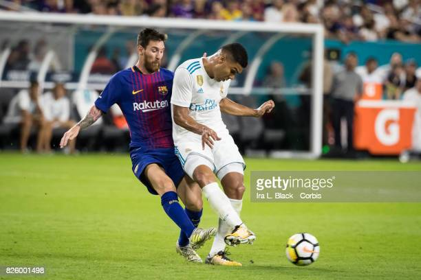 Casemiro of Real Madrid clears the ball away from Lionel Messi of Barcelona during the International Champions Cup El Clásico match between FC...