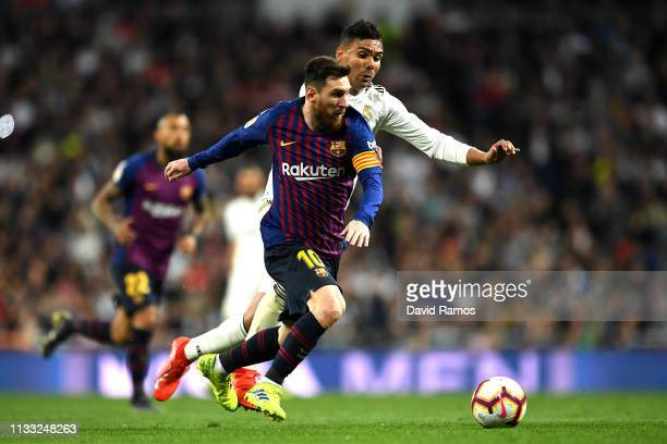 Casemiro of Real Madrid closes down Lionel Messi of Barcelona during the La Liga match between Real Madrid CF and FC Barcelona at Estadio Santiago...