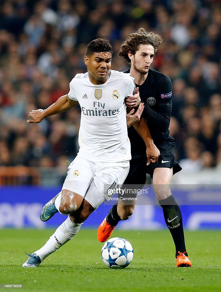 Casemiro of Real Madrid competes for the ball with Adrien Rabiot of Paris Saint-Germain during the UEFA Champions League Group A match between Real Madrid and Paris Saint-Germain at Estadio Santiago Bernabeu on November 3, 2015 in Madrid, Spain.