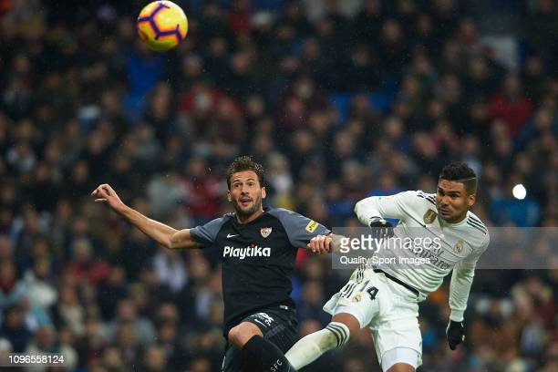 Casemiro of Real Madrid competes for the ball with Andre Silva of Sevilla FC during the La Liga match between Real Madrid CF and Sevilla FC at...
