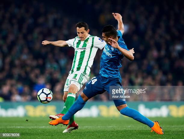Casemiro of Real Madrid competes for the ball with Andres Guardado of Real Betis during the La Liga match between Real Betis and Real Madrid at...