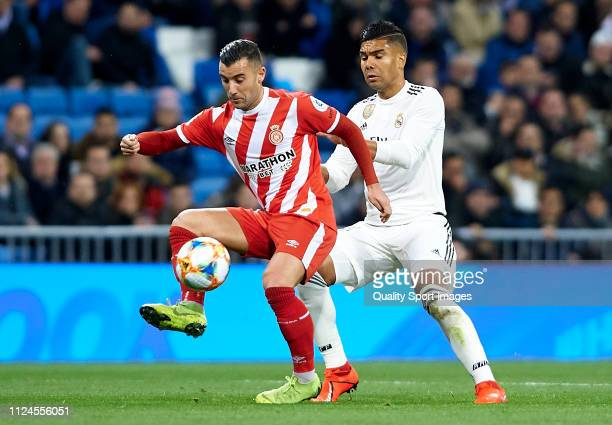 Casemiro of Real Madrid competes for the ball with Borja Garcia of Girona during the Copa del Rey Quarter Final first leg match between Real Madrid...