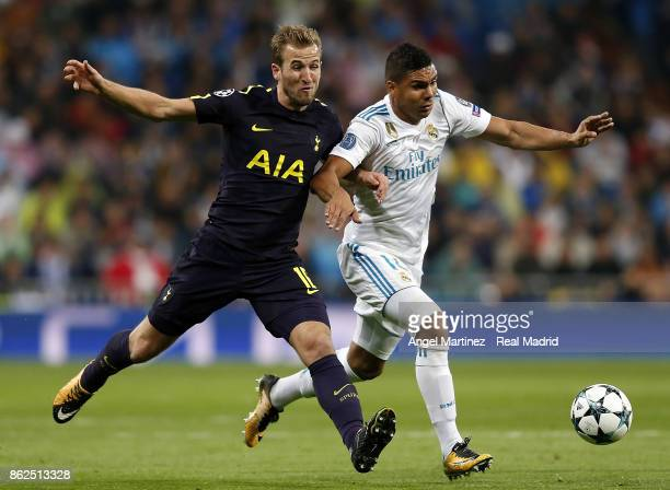 Casemiro of Real Madrid competes for the ball with Harry Kane of Tottenham Hotspur during the UEFA Champions League group H match between Real Madrid...