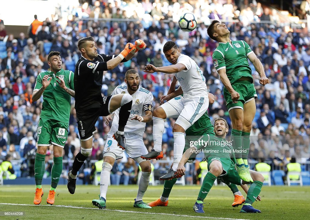 Casemiro of Real Madrid competes for the ball with Ivan Cuellar of Leganes during the La Liga match between Real Madrid and Leganes at Estadio Santiago Bernabeu on April 28, 2018 in Madrid, Spain.