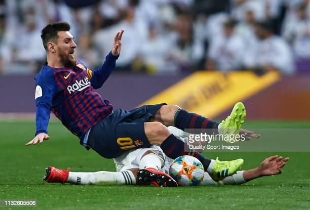 Casemiro of Real Madrid competes for the ball with Lionel Messi of Barcelona during the Copa del Rey Semi Final second leg match between Real Madrid...
