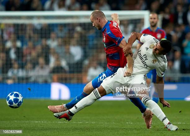 Casemiro of Real Madrid competes for the ball with Michael Krmencik of Viktoria Plzen during the Group G match of the UEFA Champions League between...
