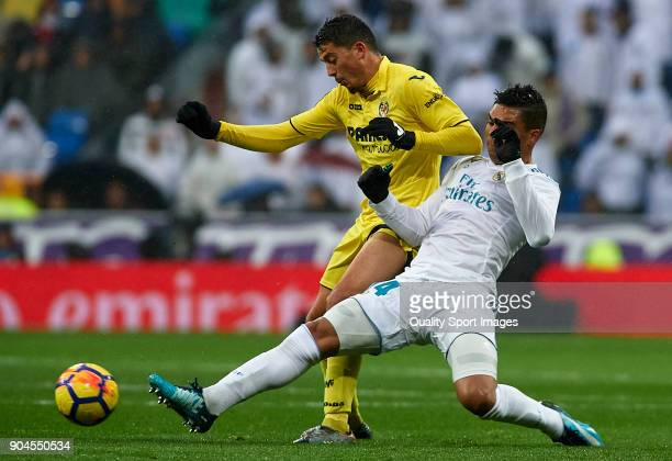 Casemiro of Real Madrid competes for the ball with Pablo Fornals of Villarreal during the La Liga match between Real Madrid and Villarreal at Estadio...