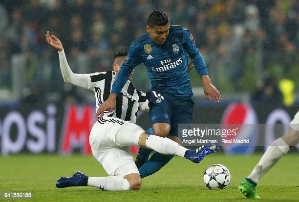 Casemiro of Real Madrid competes for the ball with Rodrigo Bentancur of Juventus during the UEFA Champions League Quarter Final Leg One match between...