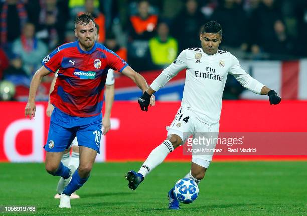Casemiro of Real Madrid competes for the ball with Tomas Chory of Victoria Plzen during the Group G match of the UEFA Champions League between...
