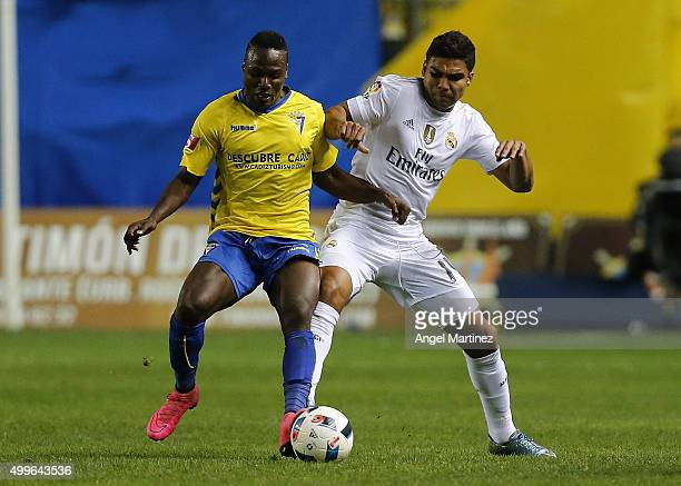 Casemiro of Real Madrid competes for the ball with Wilson Cuero of Cadiz during the Copa del Rey round of 32 first leg match between Cadiz and Real...