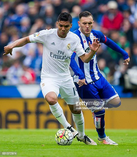 Casemiro of Real Madrid duels for the ball with Lucas Perez of RC Deportivo La Coruna during the La Liga match between RC Deportivo La Coruna and...
