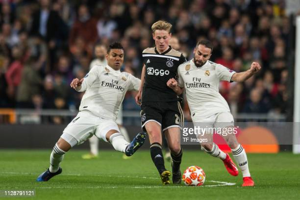 Casemiro of Real Madrid Frenkie de Jong of Ajax and Dani Carvajal of Real Madrid battle for the ball during the UEFA Champions League Round of 16...