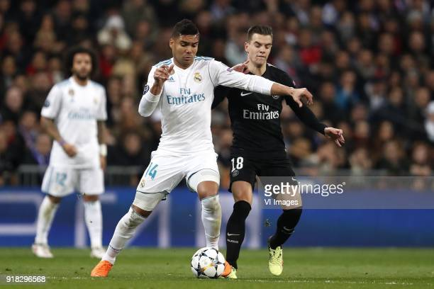 Casemiro of Real Madrid Giovani Lo Celso of Paris SaintGermain during the UEFA Champions League round of 16 match between Real Madrid and Paris...