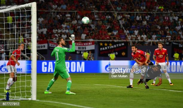 Casemiro of Real Madrid heads towards goal as David De Gea of Manchester United attempts to save during the UEFA Super Cup final between Real Madrid...