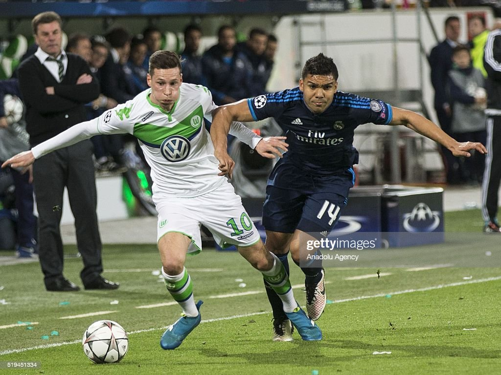 Casemiro (R) of Real Madrid in action against Julian Draxler (L) of Wolfsburg during the UEFA Champions league quarter final soccer match between Wolfsburg and Real Madrid at the Volkswagen-Arena on April 6, 2016 in Wolfsburg, Germany.