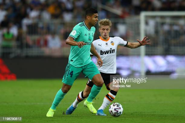 Casemiro of Real Madrid is challenged by Daniel Wass of Valencia during the Supercopa de Espana SemiFinal match between Valencia CF and Real Madrid...
