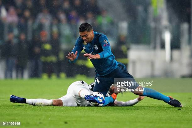 Casemiro of Real Madrid is challenged by Rodrigo Bentancur of Juventus during the UEFA Champions League Quarter Final first leg match between...