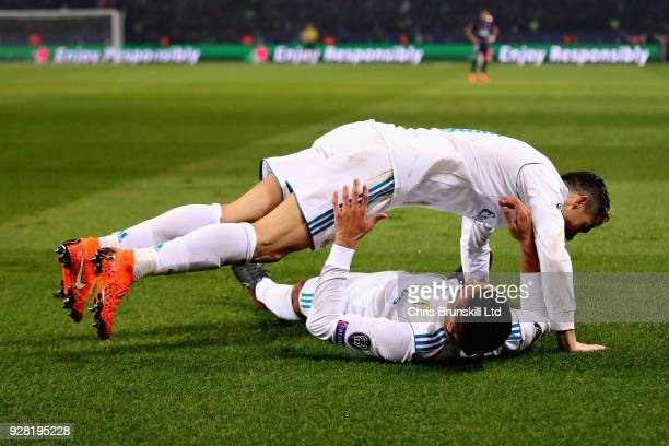 Casemiro of Real Madrid is jumped on by teammate Cristiano Ronaldo to celebrate scoring his sides second goal during the UEFA Champions League Round...