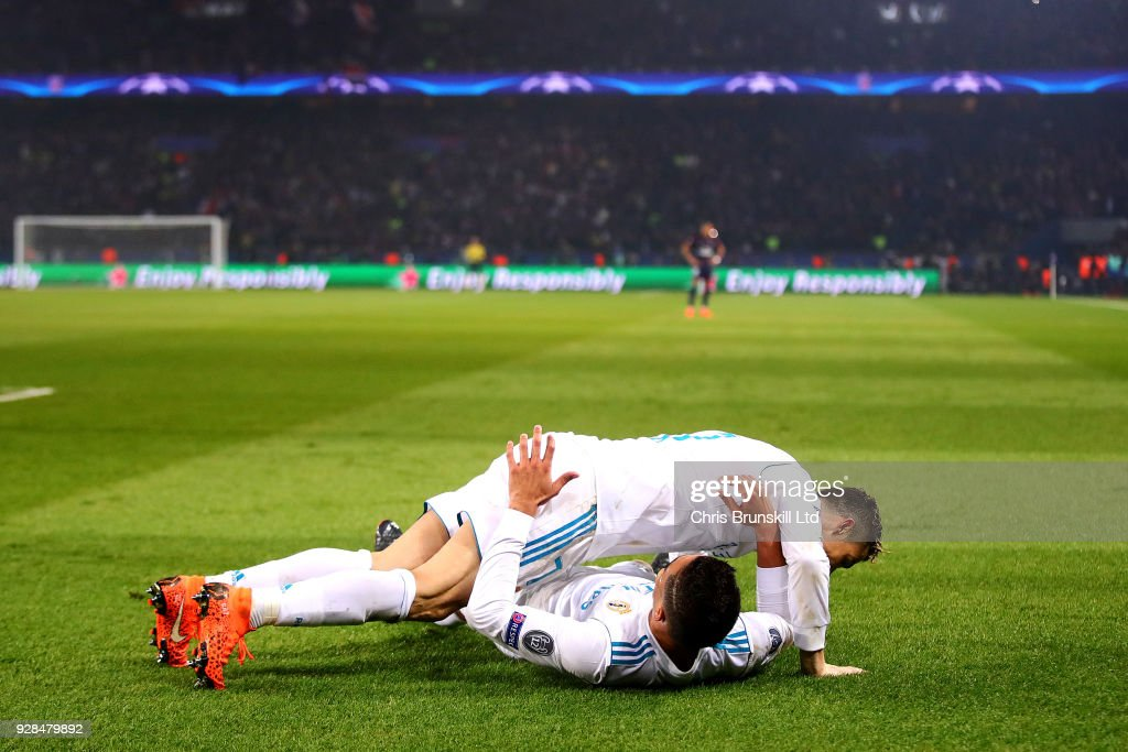 Casemiro of Real Madrid is jumped on by teammate Cristiano Ronaldo to celebrate scoring his side's second goal during the UEFA Champions League Round of 16 Second Leg match between Paris Saint-Germain and Real Madrid at Parc des Princes on March 6, 2018 in Paris, France.