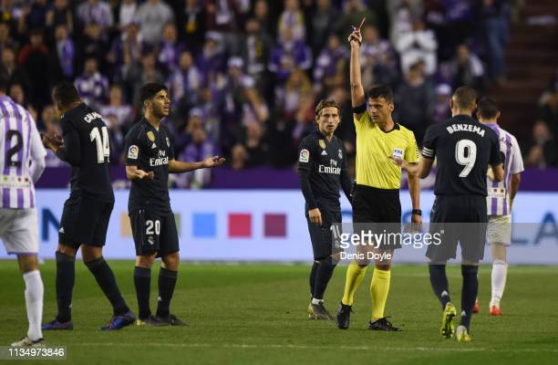 Casemiro of Real Madrid is shown a red card by referee Jesus Gil Manzano during the La Liga match between Real Valladolid CF and Real Madrid CF at...