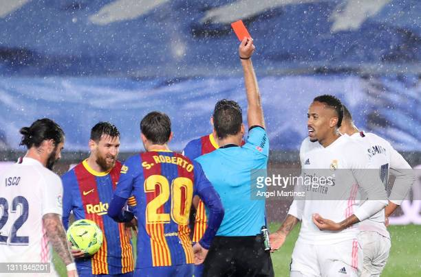 Casemiro of Real Madrid is shown a red card by Referee, Jesus Gil Manzano during the La Liga Santander match between Real Madrid and FC Barcelona at...