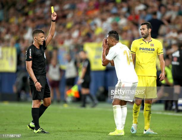 Casemiro of Real Madrid is shown a yellow card from referee Jesus Gil Manzano during the Liga match between Villarreal CF and Real Madrid CF at...