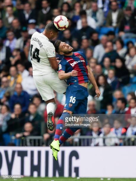 Casemiro of Real Madrid Ruben Rochina of Levante UD during the La Liga Santander match between Real Madrid v Levante at the Santiago Bernabeu on...