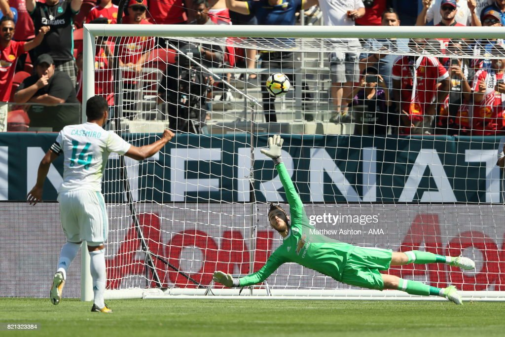 Casemiro of Real Madrid scores a goal to make it 1-1 from the penalty spot past goalkeeper David de Gea of Manchester United during the International Champions Cup 2017 match between Real Madrid v Manchester United at Levi'a Stadium on July 23, 2017 in Santa Clara, California.