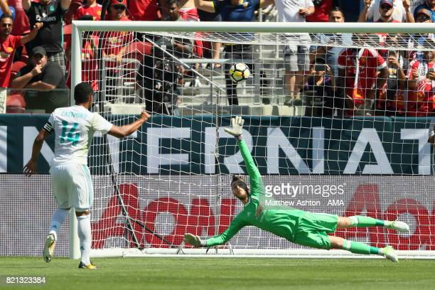 Casemiro of Real Madrid scores a goal to make it 11 from the penalty spot past goalkeeper David de Gea of Manchester United during the International...