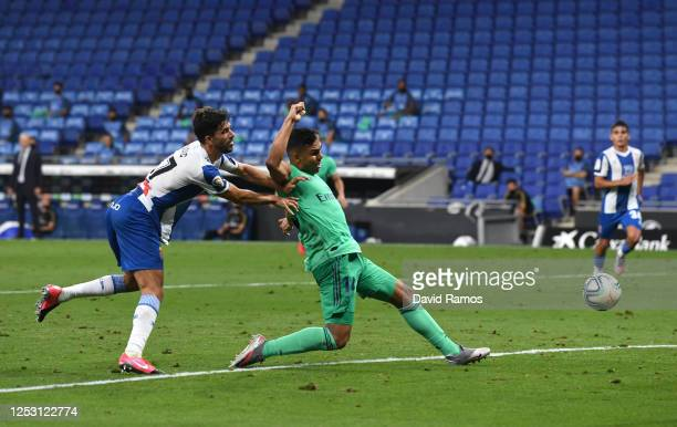 Casemiro of Real Madrid scores his sides first goal during the Liga match between RCD Espanyol and Real Madrid CF at RCDE Stadium on June 28 2020 in...
