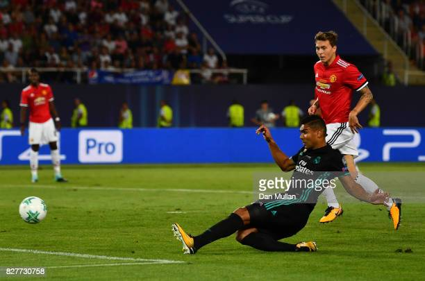 Casemiro of Real Madrid scores his sides first goal during the UEFA Super Cup final between Real Madrid and Manchester United at the Philip II Arena...